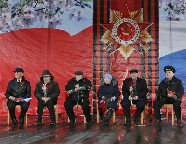 World War Two veterans take part in the Victory Day celebrations, marking the 71st anniversary of the victory over Nazi Germany in World War Two, in the town of Divnogorsk near Krasnoyarsk, Siberia, Russia, May 9, 2016. (Photo by Ilya Naymushin/Reuters)