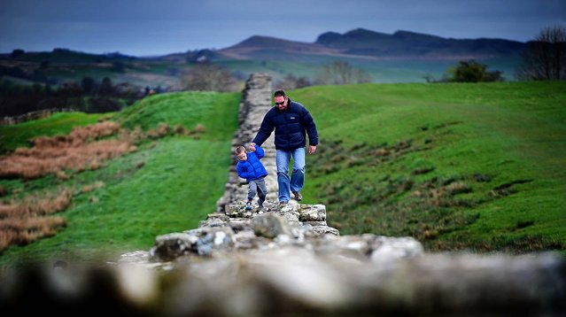 Members of the public visit Hadrian's Wall at Birdoswald, England, on April 17, 2014. The wall was started in AD 122 on the orders of Emperor Hadrian to keep out the Picts from Scotland. (Photo by Jeff J. Mitchell/Getty Images)