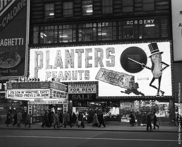 A view of the Embassy Theater and Planters Peanut Sign in Times Square, New York City, New York, 1941