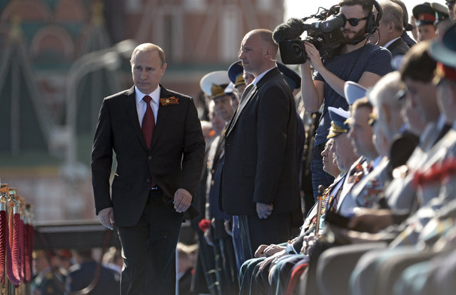 Russian President Vladimir Putin arrives for the Victory Day parade in Moscow's Red Square May 9, 2014. (Photo by Alexei Nikolskiy/Reuters/RIA Novosti/Kremlin)