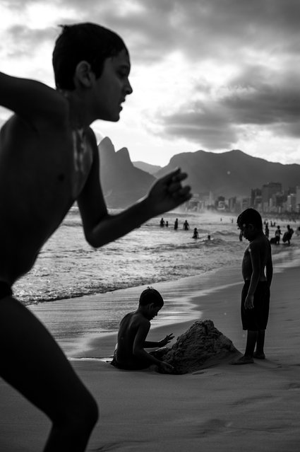 """Butterflies of Ipanema"". An image taken just before sunset on Ipanema beach in Rio. This work encapsulates essences of youth, travel and summer whils it's monochromality adds a layer of conception. Photo location: Ipanema, Rio de Janeiro. (Photo and caption by Jeremy Spierer/National Geographic Photo Contest)"