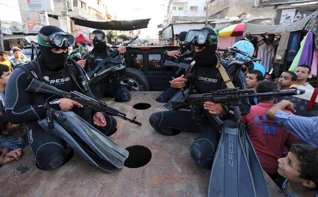 Palestinian members of the marine unit of the al-Qassam Brigades, the armed wing of the Hamas movement, take part in an anti-Israel parade in Rafah, in the southern Gaza Strip July 13, 2015. (Photo by Ibraheem Abu Mustafa/Reuters)