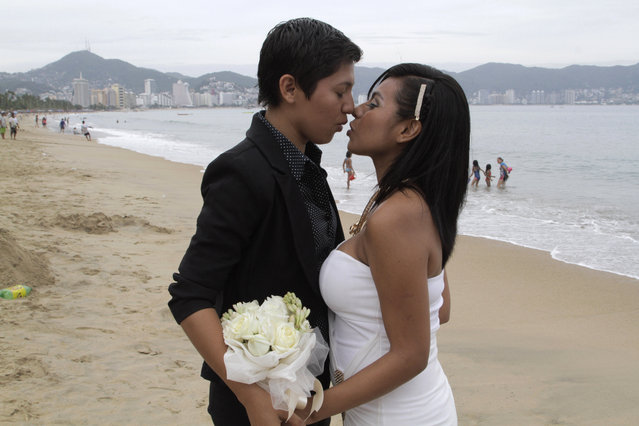 In this July 10, 2015 file photo, an unidentified same-s*x couple kisses during a group wedding for lesbian, gay, bisexual and transgender couples in Acapulco, Mexico. Mexican President Enrique Pena Nieto has proposed legalizing gay marriage. Pena Nieto said Tuesday, May 17, 2016 that he signed initiatives that would seek to enshrine same-s*x marriage in the country';s constitution and the federal civil code. (Photo by Bernandino Hernandez/AP Photo)