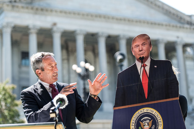 Former South Carolina Gov. Mark Sanford speaks to the media with a cardboard cutout of President Donald Trump during a campaign stop at the state house on September 16, 2019 in Columbia, South Carolina. Sanford is running against the Republican president in the primary election. (Photo by Sean Rayford/Getty Images)