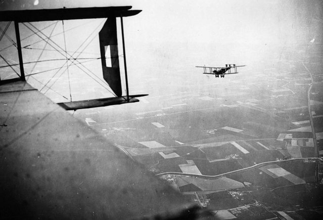 British Handley-Page bombers on a mission, Western Front, during World War I. This photograph, which appears to have been taken from the cabin of a Handley-Page bomber, is attributed to Tom Aitken. It shows another Handley-Page bomber setting out on a bombing mission. (Photo by Tom Aitken/National Library of Scotland via The Atlantic)