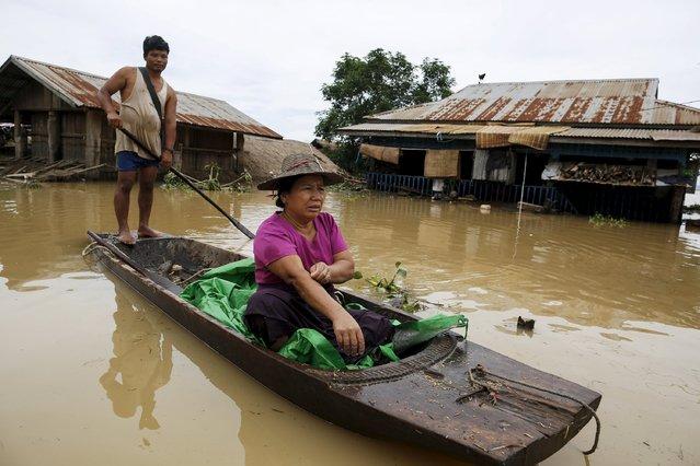 A man rows his boat along a flooded street at a village in Kawlin township, Sagaing division, Myanmar July 21, 2015. (Photo by Soe Zeya Tun/Reuters)