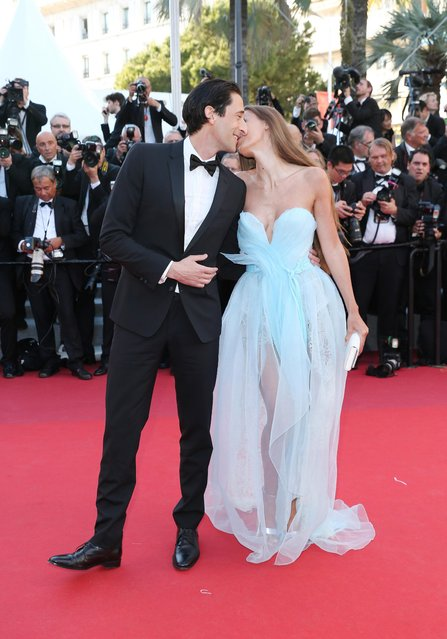 """Adrien Brody and Lara Lieto attend the """"Ismael's Ghosts (Les Fantomes d'Ismael)"""" screening and Opening Gala during the 70th annual Cannes Film Festival at Palais des Festivals on May 17, 2017 in Cannes, France. (Photo by Gisela Schober/Getty Images)"""