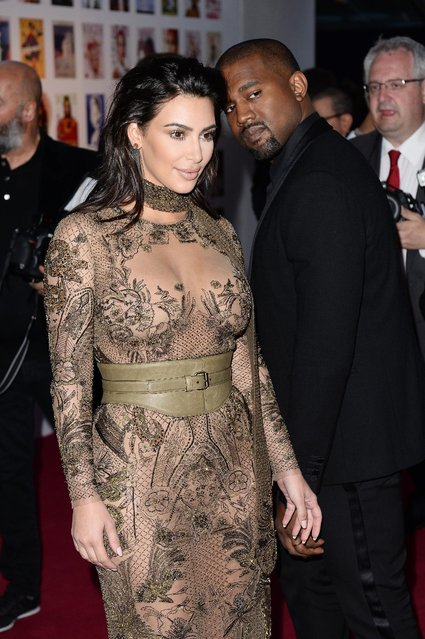 (L-R) Kim Kardashian West and Kanye West arrive for the Gala to celebrate the Vogue 100 Festival at Kensington Gardens on May 23, 2016 in London, England. (Photo by Jeff Spicer/Getty Images)