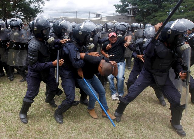 Mock rioters are detained by members of the police unit for riot for law and order restoration, during a drill at a base in Tegucigalpa, Honduras, July 30, 2015. (Photo by Jorge Cabrera/Reuters)