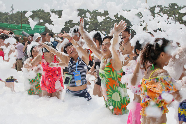 People play with foam at a water park in Yantai, Shandong province, China June 16, 2107. (Photo by Reuters/Stringer)