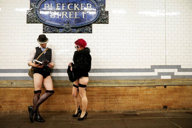 """People participate in the annual """"No Pants Subway Ride"""" in New York City, U.S., January 12, 2020. (Photo by Brendan McDermid/Reuters)"""