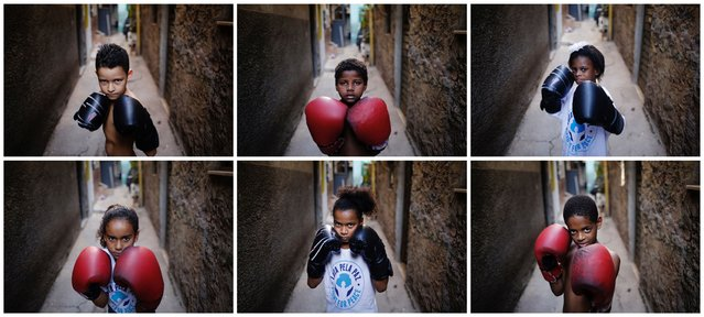 A combination picture shows children posing for a photograph at a boxing school in the Mare favela of Rio de Janeiro. (Photo by Nacho Doce/Reuters)