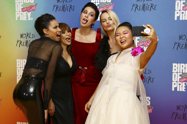 "Actresses from left Jurnee Smollett-Bell, Rosie Perez, Mary Elizabeth Winstead, Margot Robbie and Ella Jay Basco pose for a selfie photo upon arrival at the world premiere of ""Birds of Prey"" in London, Wednesday, January 29, 2020. (Photo by Joel C. Ryan/Invision/AP Photo)"