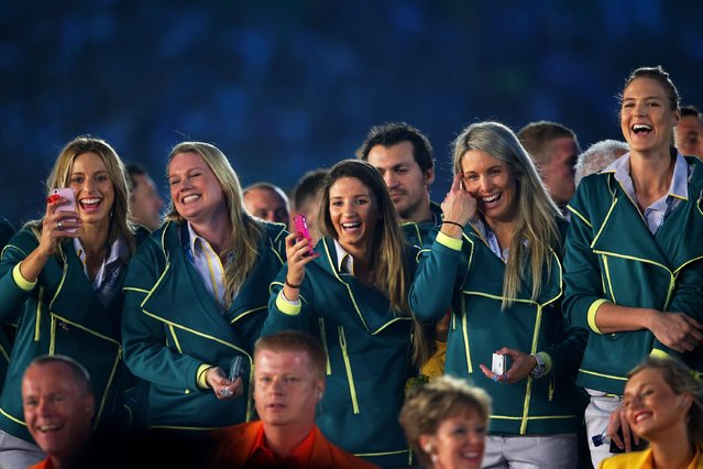 Athletes from Australia enjoy the atmopshere during the Opening Ceremony for the Glasgow 2014 Commonwealth Games at Celtic Park on July 23, 2014 in Glasgow, Scotland. (Photo by Chris Jackson/Getty Images)