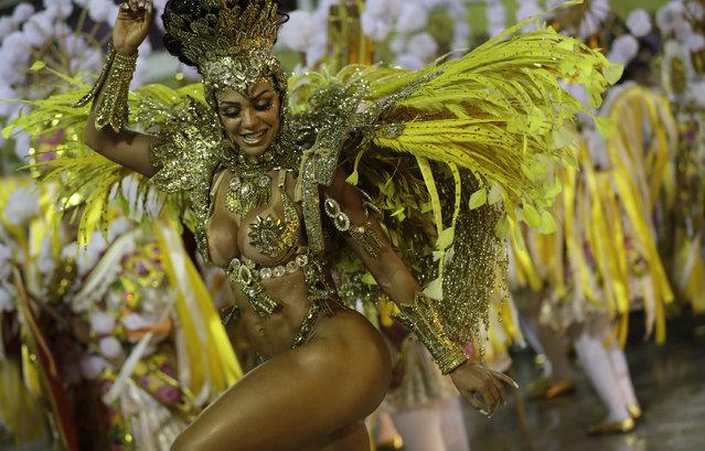 A performer from the Sao Clemente samba school parades during Carnival celebrations at the Sambadrome in Rio de Janeiro, Brazil, Monday, February 24, 2020. (Photo by Silvia Izquierdo/AP Photo)
