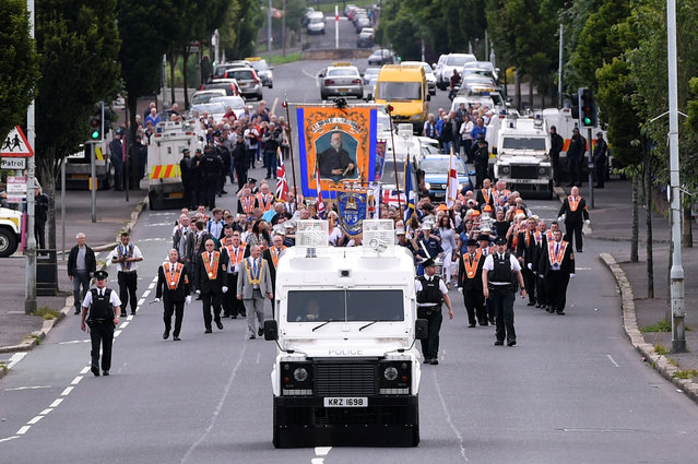 The Twelfth of July  Orange Order March arrives onto the Crumlin Road in Belfast, Northern Ireland, July 12, 2016. (Photo by Clodagh Kilcoyne/Reuters)