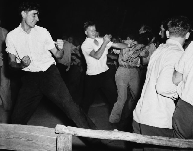 Fighting rages at picnic grove in Peekskill, New York, the night of August 27,1949 as veterans break up scheduled concert by black singer Paul Robeson. (Photo by AP Photo)