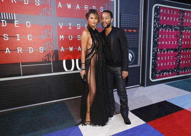 Model Chrissy Teigen and her husband, musician John Legend, arrive at the 2015 MTV Video Music Awards in Los Angeles, California August 30, 2015. (Photo by Mario Anzuoni/Reuters)