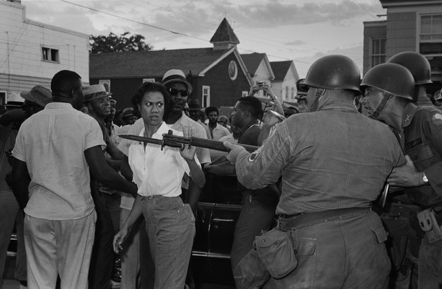 Activist Gloria Richardson pushes by the National Guard in Cambridge, Md. in June, 1963. (Photo by Fred Ward/Award Agency)