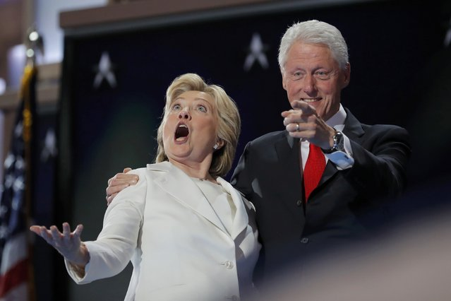 Democratic presidential nominee Hillary Clinton and her husband former president Bill Clinton react to the balloon drop after she accepted the nomination on the fourth and final night at the Democratic National Convention in Philadelphia, Pennsylvania, U.S. July 28, 2016. (Photo by Jim Young/Reuters)