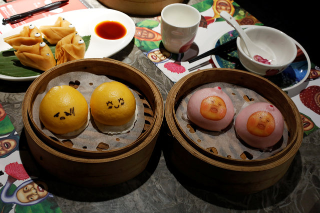 Chocolate buns (lower L), milk custard buns (R) and deep-fried dumplings (upper L) are displayed for the photographer at Dim Sum Icon restaurant in Hong Kong, China July 25, 2016. (Photo by Bobby Yip/Reuters)