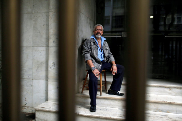 """Israel Mario da Silva, a 59-year-old watchman poses for a portrait at his place of work in Rio de Janeiro, Brazil, June 30, 2016. Israel says, """"I can't buy any tickets for the Olympics because they are too expensive for me"""", he also hopes the impact of the Olympics will be positive because Rio de Janeiro is now a better city with improved public transport services and the Olympic Park. (Photo by Pilar Olivares/Reuters)"""