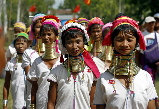 Padaung ethnic women arrive to listen to the speech of Myanmar opposition leader Aung San Suu Kyi (not in picture), Chairwoman of the National League for Democracy (NLD) party, during Suu Kyi's first official election campaign at Demoso township of Kayah State, eastern Myanmar, 10 September 2015. (Photo by Lynn Bo Bo/EPA)