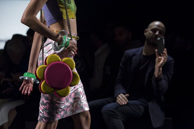 An audience member looks on as a model presents a creation from the Jeremy Scott Spring/Summer 2016 collection during New York Fashion Week in New York, September 14, 2015. (Photo by Andrew Kelly/Reuters)