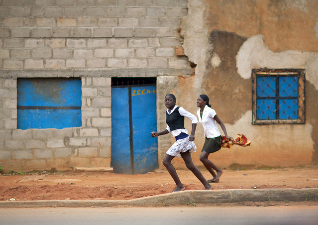 """Late for school in Huambo – Angola"". (Eric Lafforgue)"