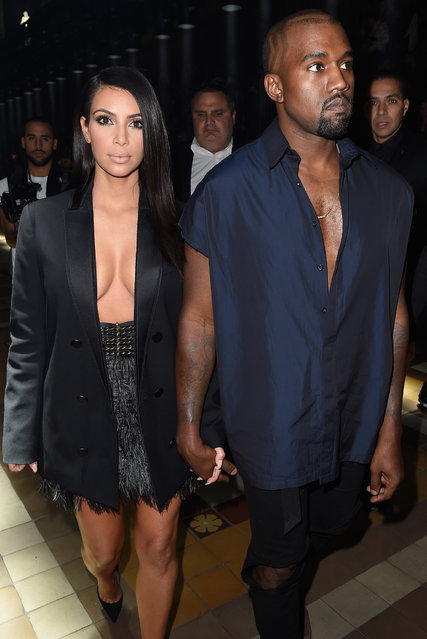 (L-R) Kim Kardashian and Kanye West attend the Lanvin show as part of the Paris Fashion Week Womenswear Spring/Summer 2015 on September 25, 2014 in Paris, France. (Photo by Pascal Le Segretain/Getty Images)