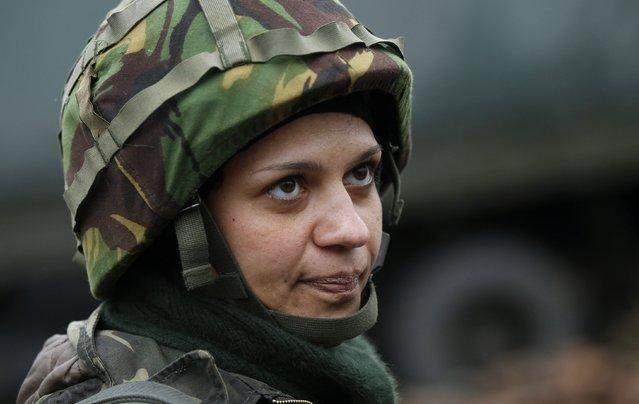 Ukrainian servicewoman Nadie, 36, stands at the military camp in the village of Luhanske, eastern Ukraine September 24, 2014. (Photo by David Mdzinarishvili/Reuters)