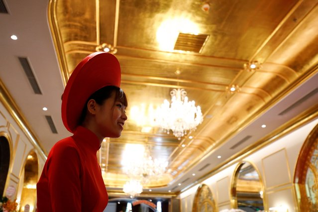 An employee in traditional dress is seen in the newly-inaugurated Dolce Hanoi Golden Lake luxury hotel, which features gold plated exteriors and interiors, after the government eased a nationwide lockdown following the global outbreak of the coronavirus disease (COVID-19), in Hanoi, Vietnam on July 2, 2020. (Photo by Reuters/Kham)