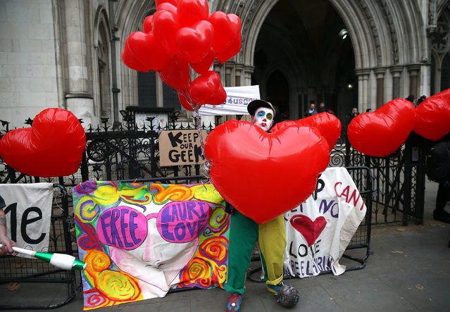 Supporters of alleged British computer hacker Lauri Love protest at the Royal Courts of Justice in the Strand, central London, Britain, 29 November 2017. Love is appealling the decision of his extradition to the United States, where he is wanted on three warrants from the US districts of New York, Eastern District of Virginia and New Jersey. Love is accused of hacking into US government agencies, including the US Federal Reserve, NASA and the US Army. (Photo by Neil Hall/EPA/EFE)