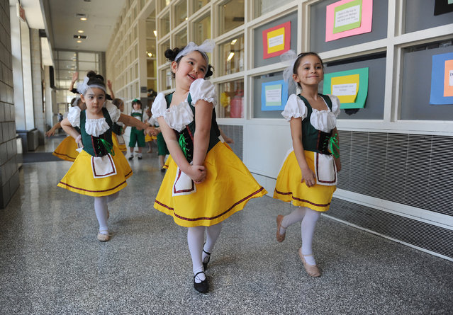 """""""Happy to Perform"""". Kindergartners make their way to the stage of the P.S./I.S. 89 school stage for a holiday performance. Photo location: New York City. (Photo and caption by Carl Glassman/National Geographic Photo Contest)"""