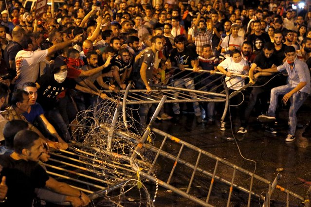 """Lebanese protesters remove barriers during a protest in Martyr square, Downtown Beirut, Lebanon October 8, 2015. Lebanese security forces fired a water cannon at scores of anti-government protesters on Thursday, Reuters witnesses said. The crowd chanted """"the people want the fall of the regime"""" as riot police surrounded them in downtown Beirut. (Photo by Mohamed Azakir/Reuters)"""