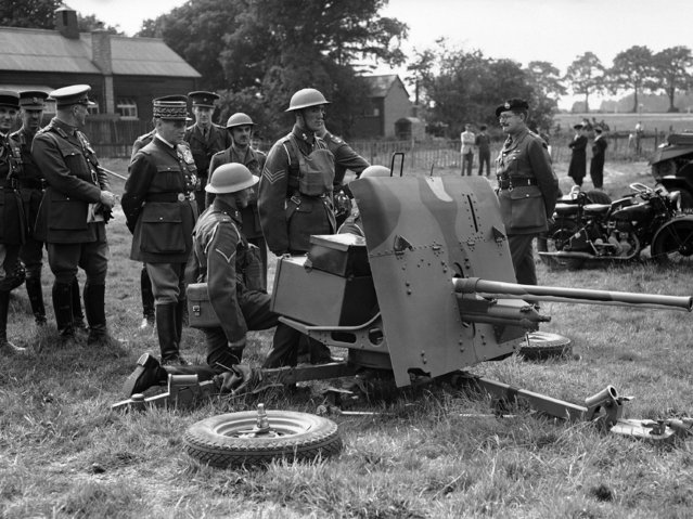 General Maurice Gamelin, General Officer commanding the French Armies, is on a four day visit to England. He went to the staff college at Minley and is seen inspecting an anti-tank gun at Aldershot, on June 7, 1939. (Photo by AP Photo)