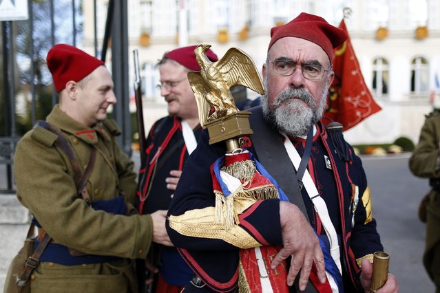 """History enthusiasts of the French association """"Arquebusiers de l'Est"""", dressed as soldiers of 3rd regiment of Zouave, attend an Armistice Day ceremony to commemorate the end of World War One at Epernay, eastern France, November 11, 2014. (Photo by Charles Platiau/Reuters)"""