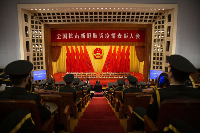 Members of Chinese military band watch an event to honor some of those involved in China's fight against COVID-19 at the Great Hall of the People in Beijing, Tuesday, September 8, 2020. (Photo by Mark Schiefelbein/AP Photo)