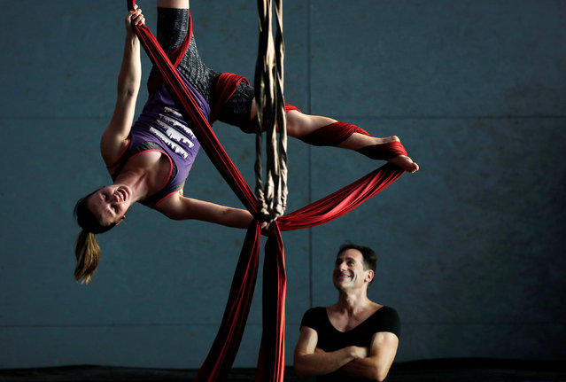 Jeff Kirschner (R) watches instructor Hayley Larson practice on the silks at the Aloft Loft circus training and teaching school which was converted from a church, in Chicago, Illinois, U.S., September 20, 2016. (Photo by Jim Young/Reuters)