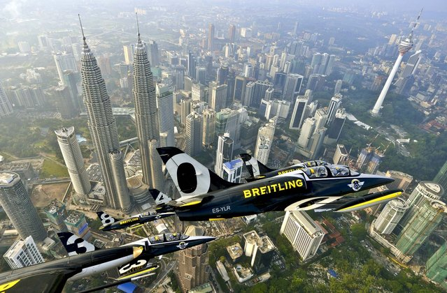 The Breitling Jet Team flies over the Petronas Towers above Kuala Lumpur, Malaysia, on March 14, 2013. The show  is the fourth stop of their Breitling Asian Tour. (Photo by Katsuhiko Tokunaga/Breitling)