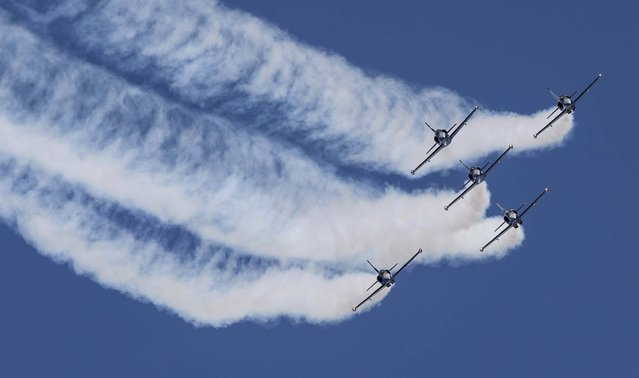 Aero Albatros jets of the Breitling Jet Team perform during an aerobatics display at the Subang Skypark near Kuala Lumpur, on March 16, 2013. Malaysia is the fourth stop of the Breitling Asian Tour, which is making its debut in the country. (Photo by Vincent Thian/Associated Press)