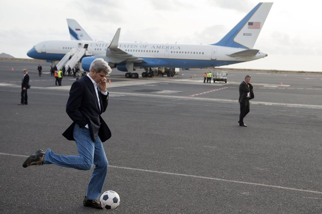 U.S. Secretary of State John Kerry kicks a soccer ball around during an airplane refuelling stop on Sal Island in Cape Verde, enroute to Washington DC, in this May 5, 2014 file photo. (Photo by Saul Loeb/Reuters)