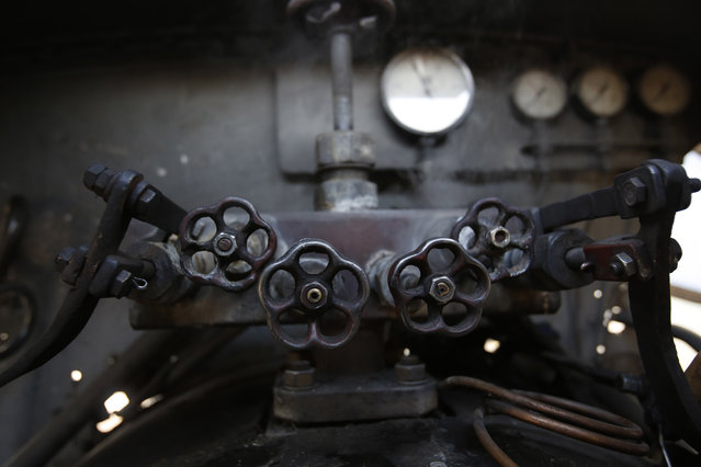 Part of the mechanics inside the driver's cab of a steam engine at the coal mine of Oskova in the Bosnian town of Banovici, 140 kms (86.9 miles) north of Sarajevo, on Monday November 24, 2014. (Photo by Amel Emric/AP Photo)