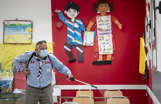 Tunisian scouts carry out disinfection works at Ibn Khaldun school within measures taken against coronavirus (Covid-19) pandemic in Tunis, Tunisia on November 11, 2020. (Photo by Yassine Gaidi/Anadolu Agency via Getty Images)