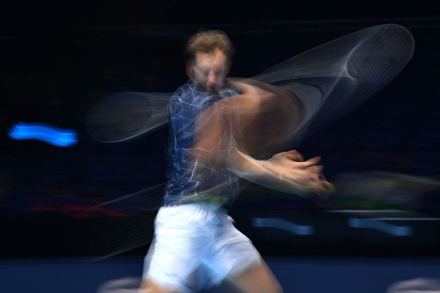 Russia's Daniil Medvedev returns against Germany's Alexander Zverev in their men's singles round-robin match on day two of the ATP World Tour Finals tennis tournament at the O2 Arena in London on November 16, 2020. (Photo by Glyn Kirk/AFP Photo)