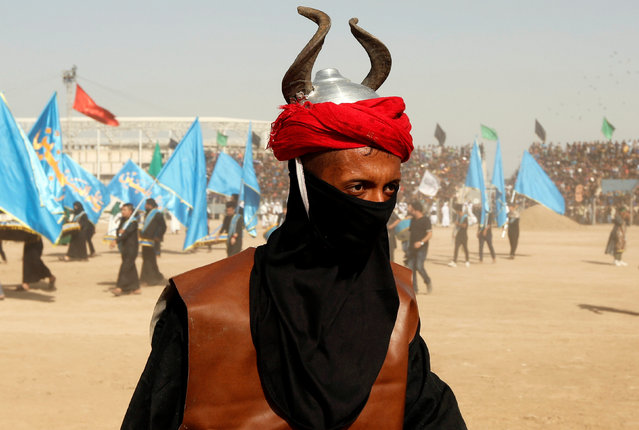 Local actors dressed as ancient warriors re-enact a scene from the 7th century battle of Kerbala during commemoration in Sadr City, Baghdad, Iraq October 12, 2016. (Photo by Ahmed Saad/Reuters)