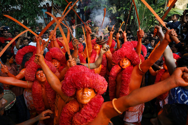 Hindu devotees dance on the street as they celebrate Lal Kach festival in Narayanganj, Bangladesh, April 13, 2018. (Photo by Mohammad Ponir Hossain/Reuters)