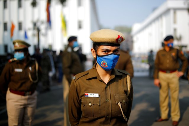 A police officer stands guard out of a venue where farmer leaders meet with government representatives in New Delhi, India, December 5, 2020. (Photo by Adnan Abidi/Reuters)