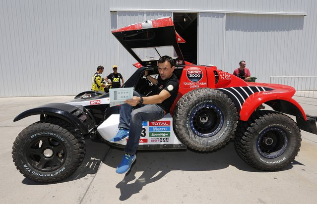Buggy MD Rallye pilot Pierre Lauchame of France arrives for technical verification ahead of the Dakar Rally 2015 in Buenos Aires January 2, 2015. (Photo by Enrique Marcarian/Reuters)