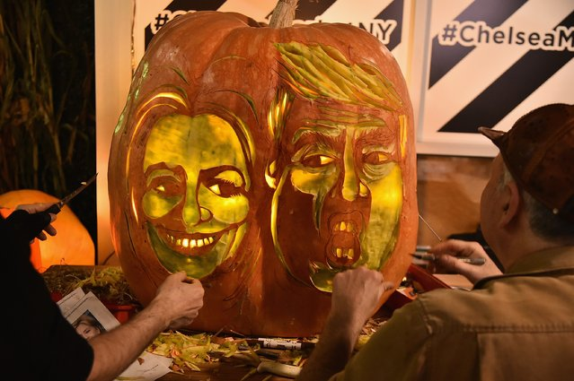 Master Carver Hugh McMahon Creates Giant Donald Trump And Hillary Clinton Pumpkin at Chelsea Market on October 28, 2016 in New York City. (Photo by Theo Wargo/Getty Images)